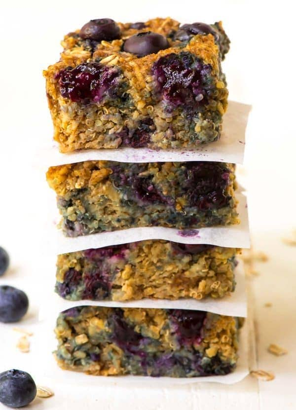 Healthy Blueberry Quinoa Breakfast Bars. NO BUTTER, NO OIL, and NO SUGAR! Gluten free, dairy free, and naturally sweetened with maple syrup. Simple, clean-eating recipe with baked oatmeal, quinoa, and almond butter. Delicious will keep you full all morning! Recipe at wellplated.com | @wellplated