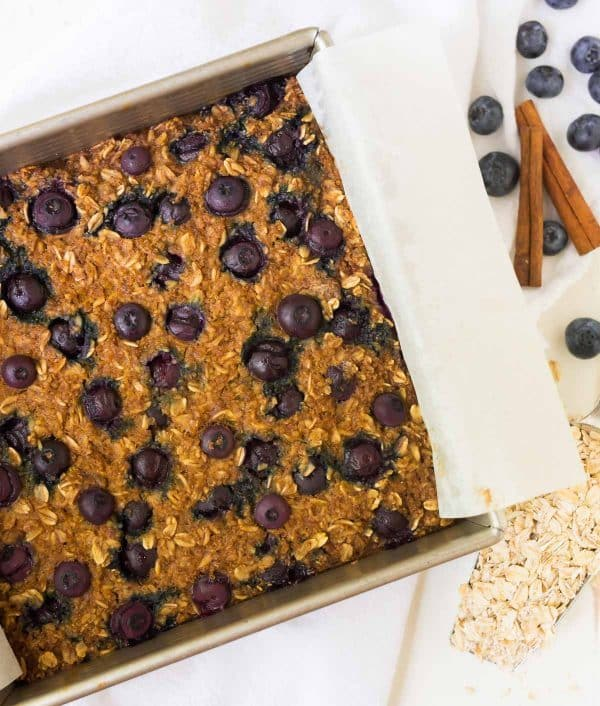 Quinoa Breakfast Bars with Blueberries recipe – Packed with fresh blueberries, almond butter or peanut butter, and maple syrup. Gluten free, dairy free, and vegan, this healthy recipe is easy to make and tastes absolutely delicious! Recipe at wellplated.com | @wellplated