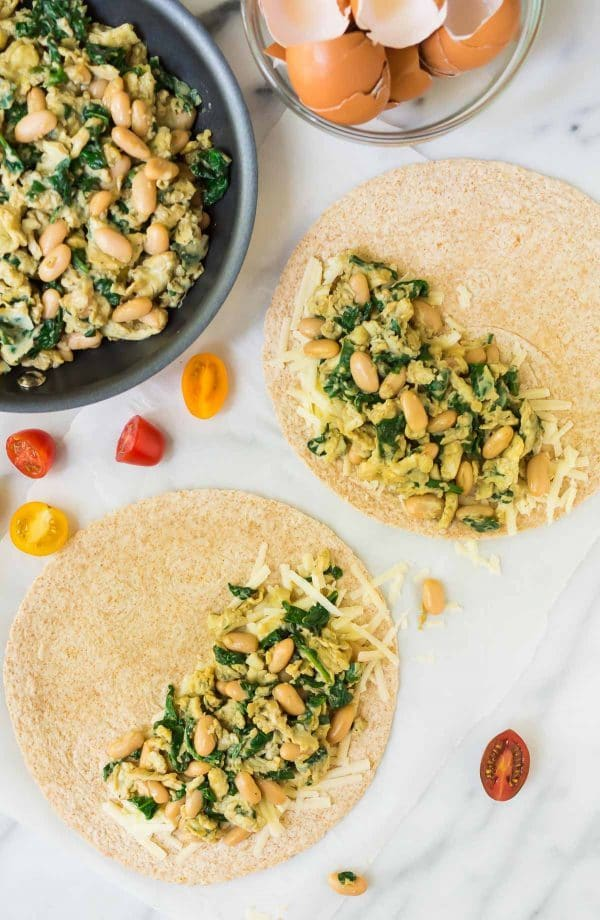 Healthy Breakfast Quesadilla recipe. Easy, make ahead recipe with scrambled eggs, spinach, cheese, and white beans. Simple, filling, and freezer friendly! Recipe at wellplated.com | @wellplated