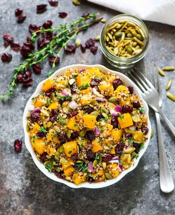 Maple Roasted Butternut Squash Quinoa Salad with Cranberries. Healthy, gluten free, and perfect for easy lunches and dinners! Add feta or arugula, or enjoy simply as it is. Recipe at wellplated.com | @wellplated
