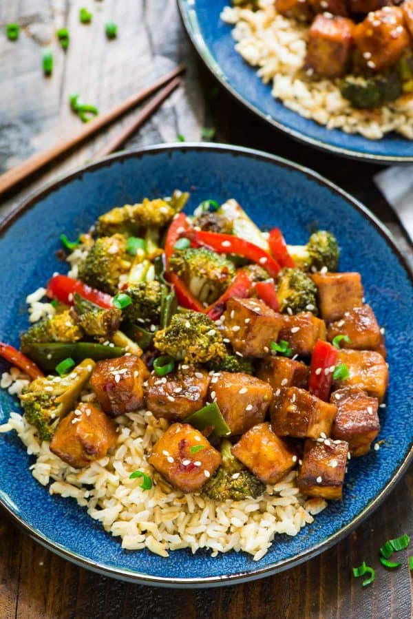 General Tso's Tofu. A healthy, DELICIOUS version of the popular takeout dish. Easy and made with everyday ingredients. Filled with fresh veggies and protein in the most flavorful General Tso's sauce. ONE PAN, vegan, and gluten free!
