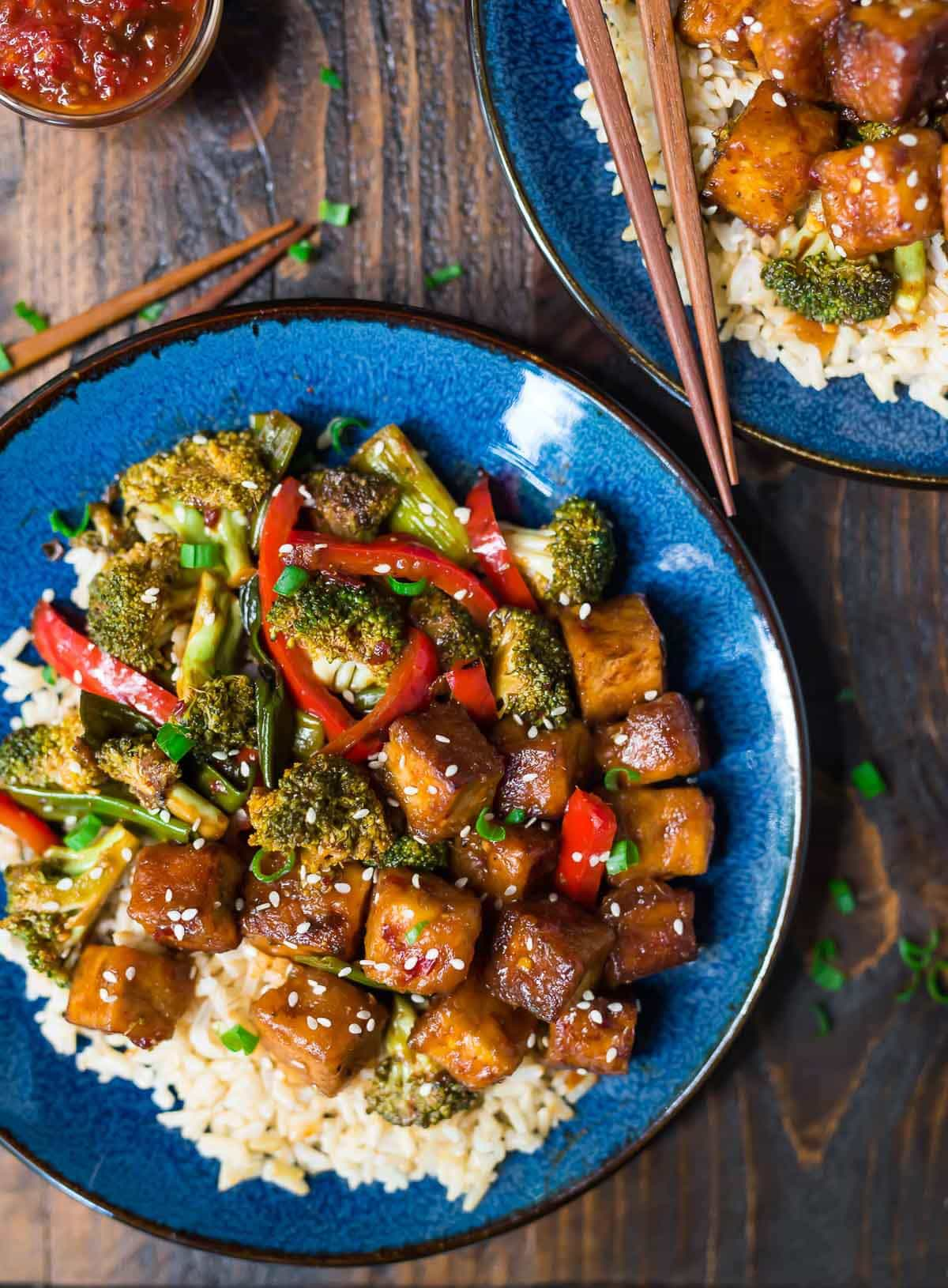 General Tso Tofu. DELICIOUS, easy and healthy! A lighter version of everyone's favorite General Tso's stir fry that's vegan, gluten free, and cooks in just one pan!