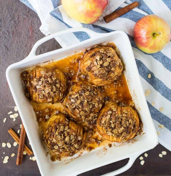 Hasselback-style baked apples with oatmeal streusel. A healthy dessert recipe that's easy to scale up for parties or make in a small batch for two!