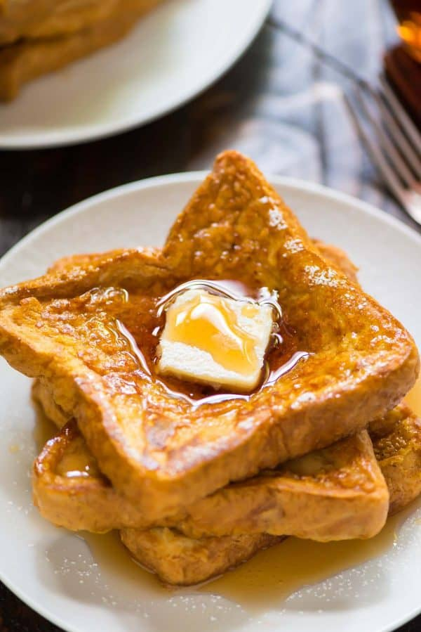 Healthy Pumpkin French Toast. Soft and fluffy with the BEST fall spices. Easy recipe that's perfect for fall breakfasts!