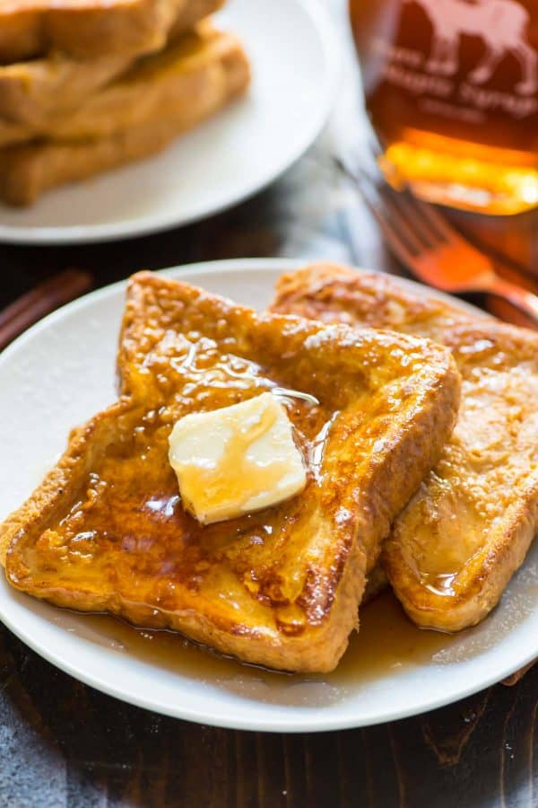 INCREDIBLE Pumpkin French Toast. Easy, healthy recipe! Soft, fluffy and PACKED with pumpkin flavor and fall spices. This is our family's favorite weekend breakfast!