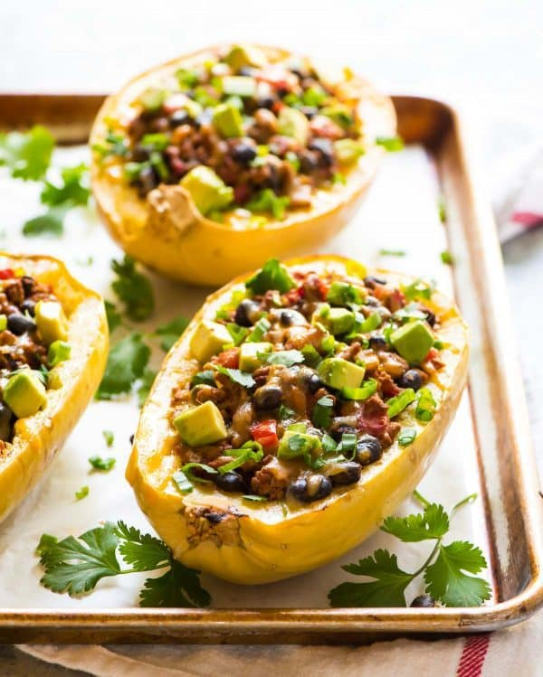 Taco Spaghetti Squash Boats with Ground Turkey, Black Beans, and Cheese. Easy, delicious, and low carb! Recipe at wellplated.com