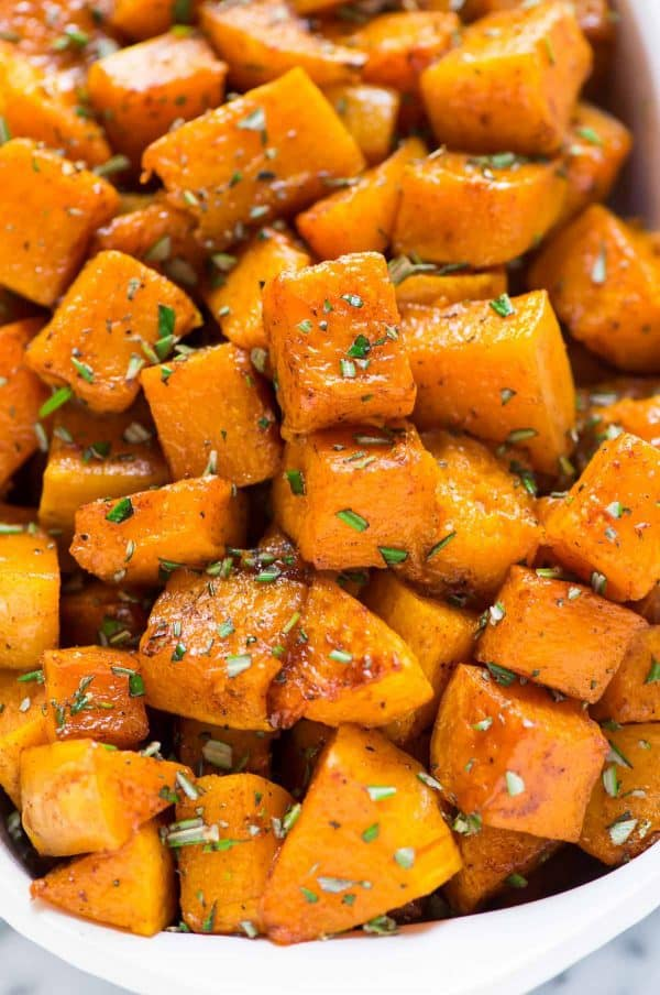 Easy maple roasted butternut squash cubes with cinnamon and fresh rosemary