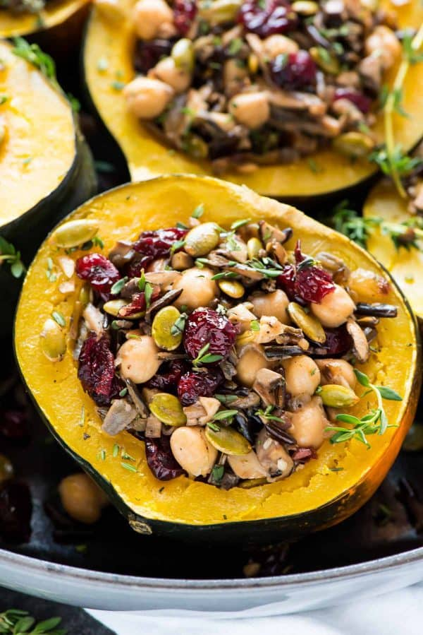 Wild Rice Cranberry Stuffed Acorn Squash, made quick and easy in the Instant Pot! With chickpeas, mushrooms, and pumpkin seeds, this healthy, vegetarian meal is one of our favorites.
