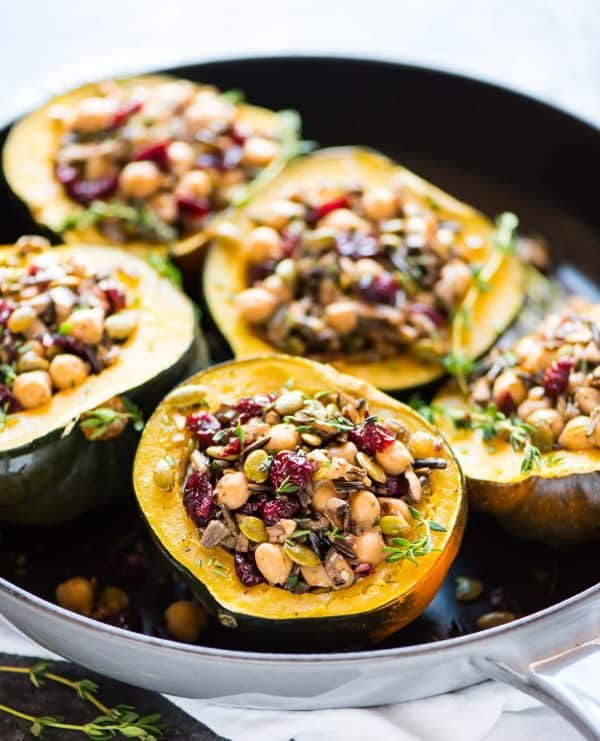 Instant Pot Acorn Squash stuffed with wild rice, cranberry, mushroom, and chickpeas. DELICIOUS, healthy, vegan, and gluten free! A perfect vegetarian meal.