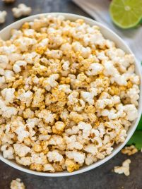 "Easy ""Cheesy"" Taco Popcorn. Chili powder, fresh lime zest, and nutritional yeast make a delicious, healthy, dairy free party appetizer or office snack. Perfect for movie nights! #popcorn #tacopopcorn #dairyfree #healthysnack #healthyappetizer"