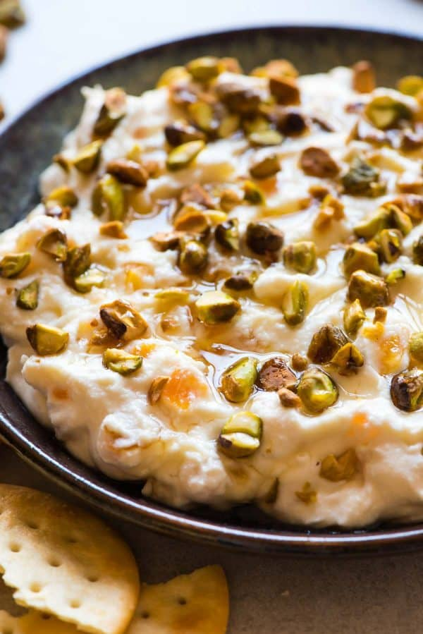 Honey Ricotta Dip with Pistachio and Apricot. A creamy dip with ricotta and cream cheese that's easy to whip together for holiday parties! Serve with a baguette or butter crackers