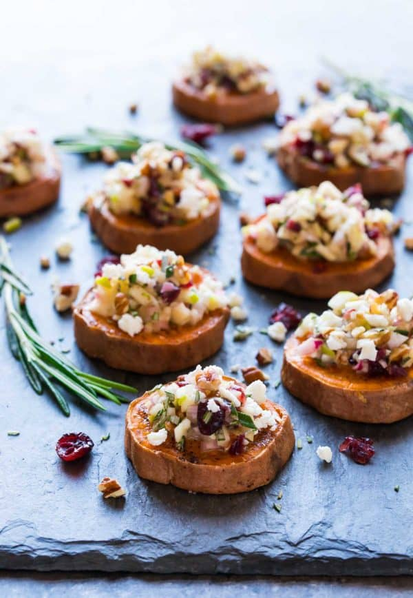 Roasted Sweet Potato Rounds with goat cheese, cranberries, apple, and pecans combined to make a delicious topping. These holiday flavors make this sweet potato rounds appetizer perfect for Thanksgiving, Christmas, and holiday parties!