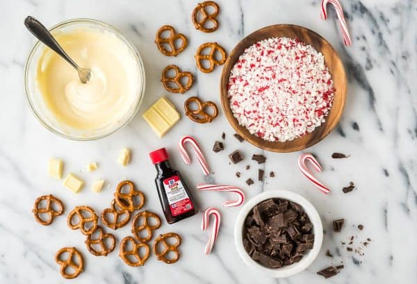 Chocolate Covered Pretzels with Peppermint. Use mini pretzels, or you could use rod shapes to make chocolate covered pretzel sticks. Simple, festive holiday snack that everyone will love.