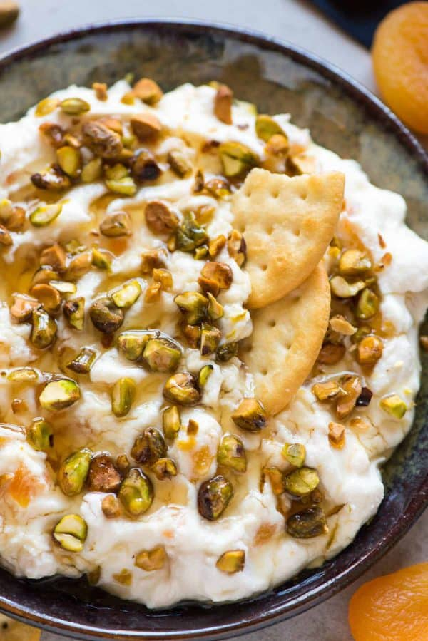 Easy Honey Ricotta Dip with Pistachio and Apricot. A simple, delicious appetizer for holiday parties. Made with cream cheese, dried apricots, honey, and pistachios!