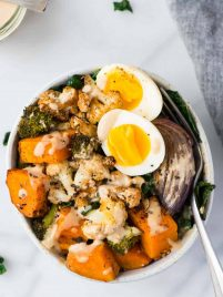 Easy and healthy Whole30 Vegetarian Power Bowl. Low carb, packed with roasted veggies, with a creamy and delicious Whole30 dressing. Top with a soft boiled egg for a filling, high protein vegetarian meal! Dairy free, gluten free, grain free, and Paleo compliant.