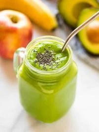 Cleansing Apple Avocado Smoothie with banana, ginger, and spinach. Vegan, high fiber, and perfect for weightloss, this easy, creamy vegan green smoothie will keep you full all morning! #greensmoothie #avocadosmoothie #healthy #weightloss
