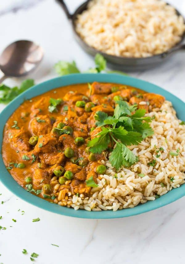 Healthy Instant Pot chicken tikka masala served in a bowl with rice and fresh herbs