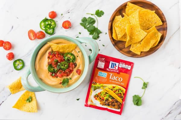 Easy Vegan Queso. BEST recipe for a flavorful, creamy queso that doesn't contain cheese! This amazing dip will go fast at any party!