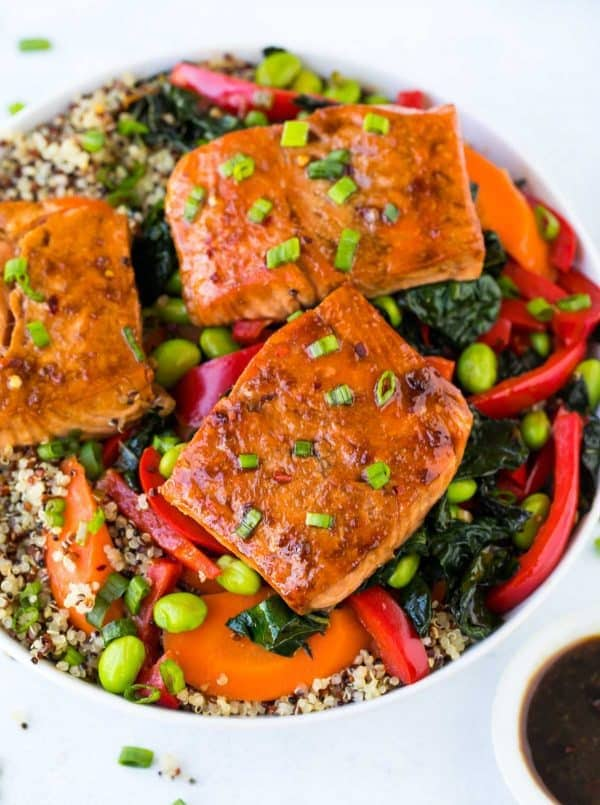 Teriyaki Salmon Bowl with Quinoa, Kale, and Fresh Veggies. A quick and easy cooked Asian Buddha bowl that's perfect for healthy lunches, meal prep, and fast dinners! Add avocado or swap any veggies you have on hand.