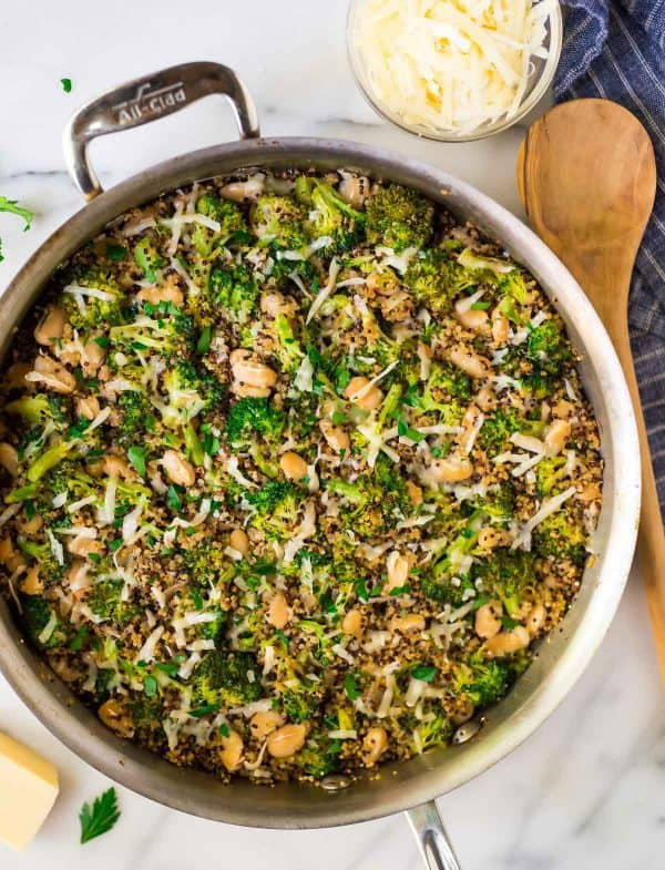 Easy One Pan Broccoli Quinoa Skillet with Parmesan and White Beans. A great option for meal prep or fast weeknight dinners! Vegetarian and protein packed.