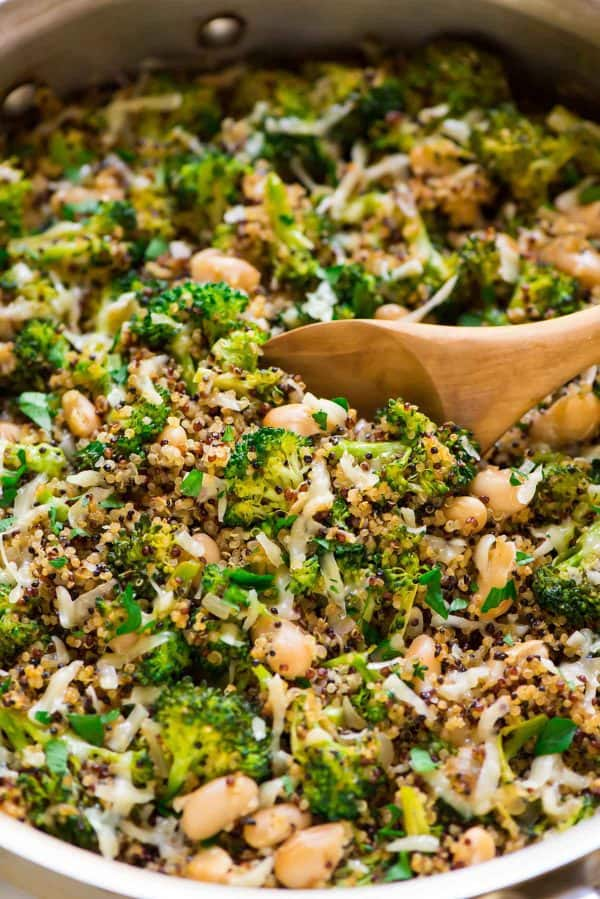 One Pan Broccoli Quinoa Skillet with Parmesan and White Beans. This vegetarian recipe is easy, cheesy, and ready in just 30 minutes! Great for dinner or for meal prep.