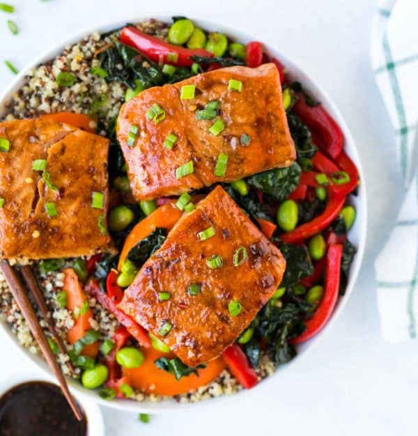 Easy Teriyaki Salmon Quinoa Bowl. A tasty, protein-packed bowl that's loaded with veggies and whole grains. Homemade teriyaki sauce with no refined sugar!