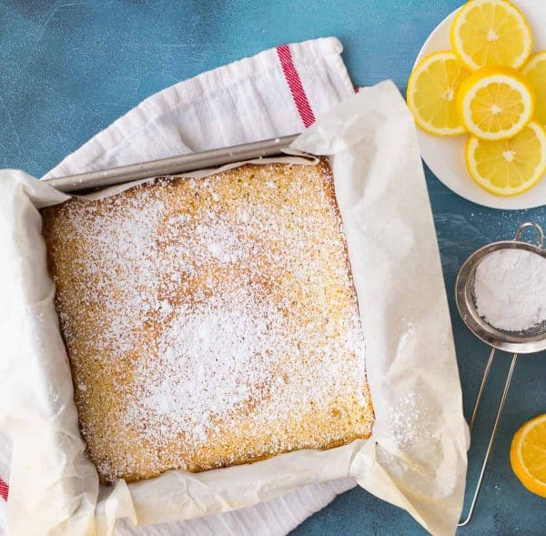 Easy lemon bars have powdered sugar sprinkled over the lightly crispy, crackly top.