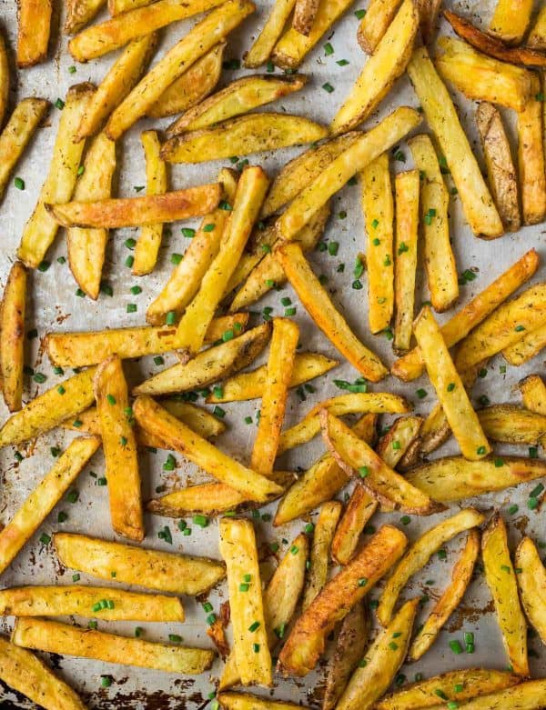 How to make Crispy Oven Baked Fries! Easy recipe that makes the most perfect, healthy baked French fries every time. Includes tips for how to reheat French fries to make them crispy again.