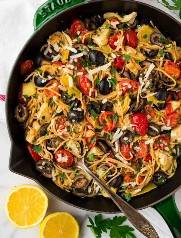 Mediterranean Pasta with artichoke, tomato, garlic, and lemon. One of our favorite fast and healthy pasta recipes! Easy to make, warm, and filled with bright flavor!