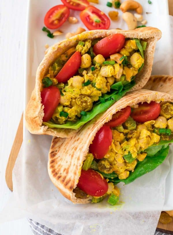 Curry Chickpea Salad Sandwich. NO MAYO! An easy, healthy recipe made with Greek yogurt, mashed chickpeas, and layers of delicious flavors and ingredients like curry and cashews. Serve inside a pita, on bread for a sandwich, or over greens for a simple and satisfying meal.