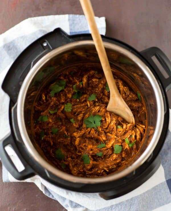 Chicken Mole made easy in the Instant Pot! The delicious sauce coats the shredded chicken perfectly.