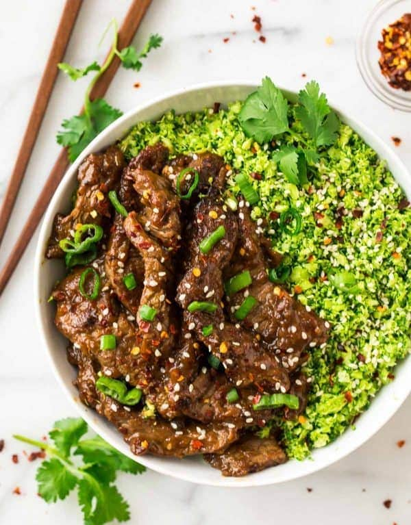 Healthy Beef and Broccoli! Easy, low carb recipe made with broccoli rice, and the most incredibly tender beef and delicious Mongolian sauce. Tastes like an authentic Chinese beef and broccoli recipe, but is made with clean eating ingredients. Perfect for busy families and meal prep dinners!