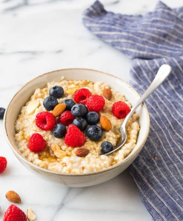 Easy Steel Cut Oatmeal. Top with berries, nuts, or nut butter to make your perfect bowl!