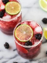 Skinny Blackberry Margarita. Simple, easy recipe with fresh lime juice, tequila, agave or simple syrup, and frozen or fresh berries. Better than Chili's or Chuys! Ultra refreshing. Recipe can make just one or a whole pitcher for a party!