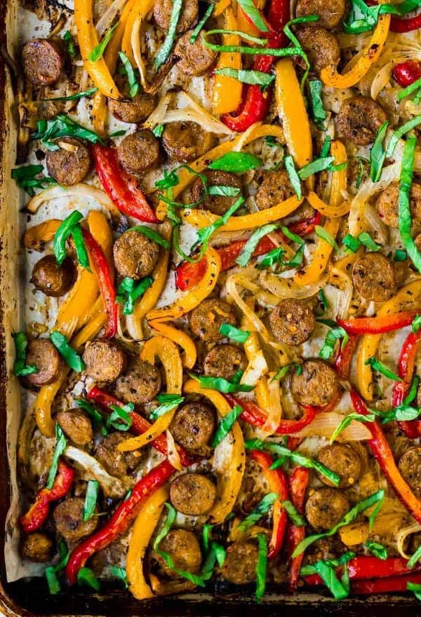 Italian Sausage and Peppers in the Oven. An easy, healthy recipe! Use these sausage and peppers to top sandwiches, in pasta, or over rice, on on their own.