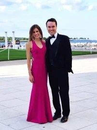 Well Plated by Erin Blogger Erin Clarke in Long Pink Dress with Husband in Tux