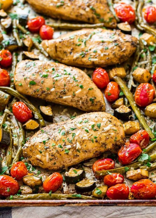 Easy and healthy Baked Italian Chicken with Tomatoes, zucchini, and green beans.