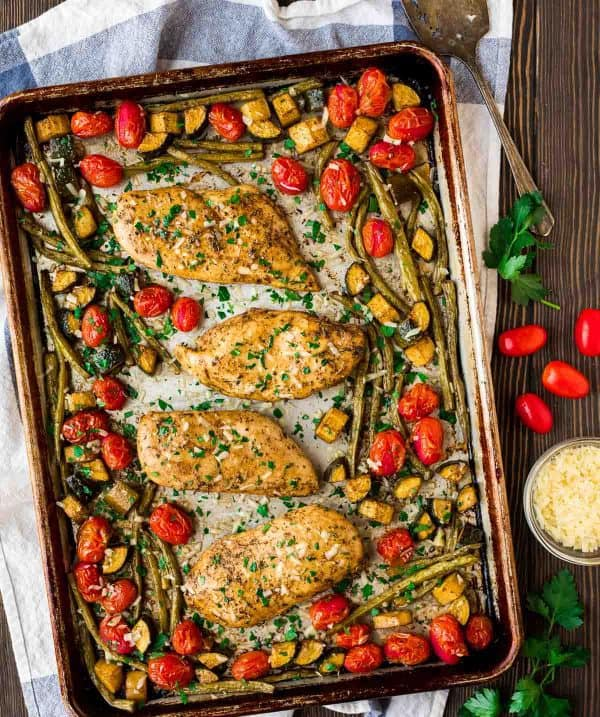 Authentic baked Italian chicken with tomatoes, zucchini, and green beans.