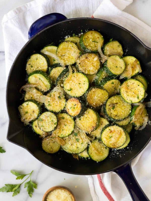 Easy Sauteed Zucchini Parmesan recipe. Add garlic, onions, and summer squash for a fast, delicious anytime side dish!