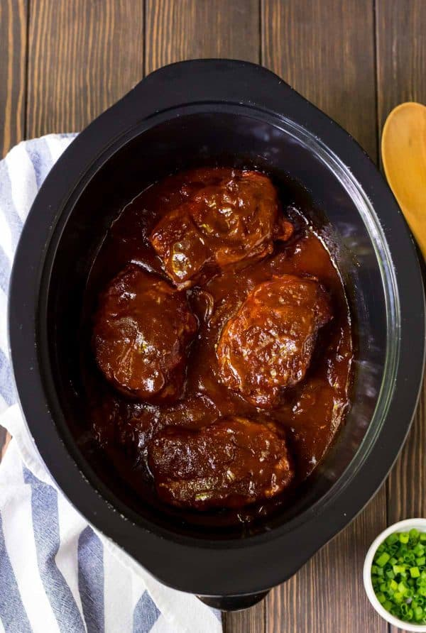 A slow cooker with barbecue pork chops