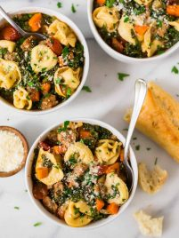 Italian Crockpot Tortellini Soup with sausage and kale. An easy, healthy crockpot recipe with chicken or turkey sausage, spinach or kale, and cheese. Creamy and comforting, this slow cooker Tuscan soup is one of the best crockpot recipes