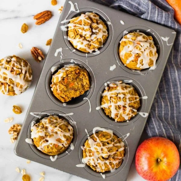 Moist Apple Carrot Muffins. An easy and healthy recipe with no sugar! Made with oatmeal, Greek yogurt, and maple syrup, they are naturally sweetened, filling, and great for healthy breakfasts and snacks. A favorite for toddlers AND for adults!