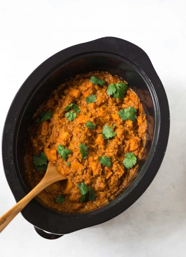 Easy Red Lentil Curry made in the slow cooker! Loaded with sweet potato and delicious spices.