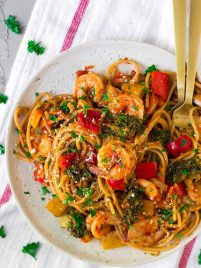 Spicy Shrimp Pasta. A fast, flavorful, healthy shrimp recipe! With garlic, lots of veggies, whole wheat spaghetti, and an easy tomato sauce, this is one of our go-to weeknight main dishes.