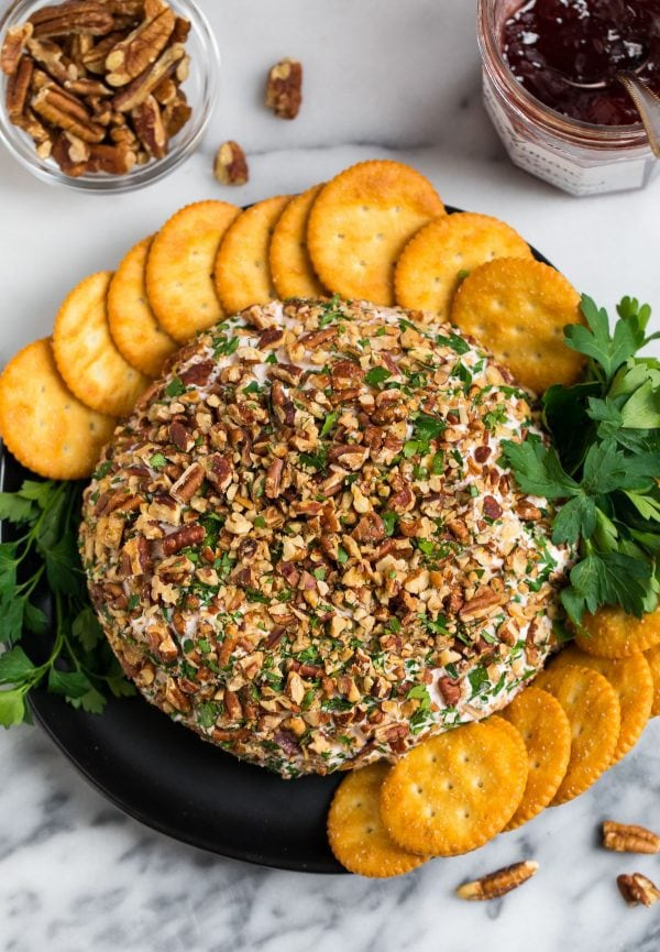 Easy Cream Cheese Ball with cheddar, strawberry preserves, and toasted pecans. A simple but delicious holiday appetizer!