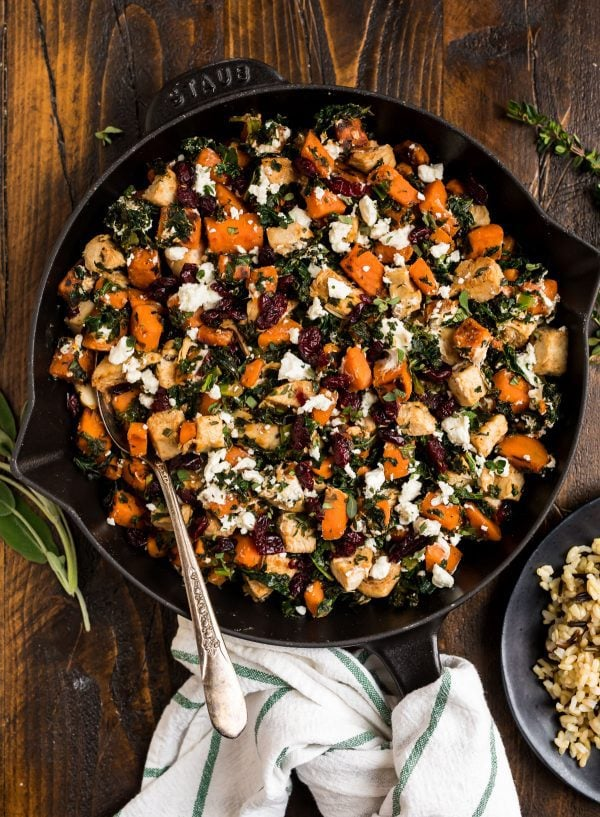 Healthy chicken dinner recipe with sweet potatoes, kale, and cranberries. Easy and delicious!
