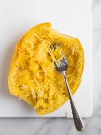 Crockpot Spaghetti Squash. How to make easy spaghetti squash in the slow cooker! Easy, healthy, and can be used with any of your favorite spaghetti squash recipes. Try it with meatballs, with sauce, and even lasagna! Vegan, low carb, keto, and gluten free.