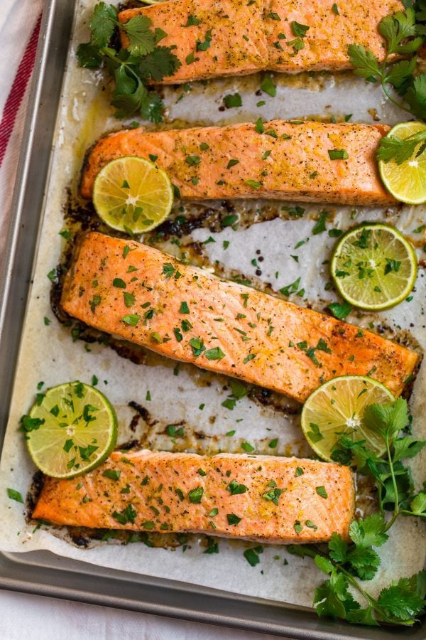 Whole30 Salmon with tomato and avocado topping. A delicious Whole30 compliant dinner!