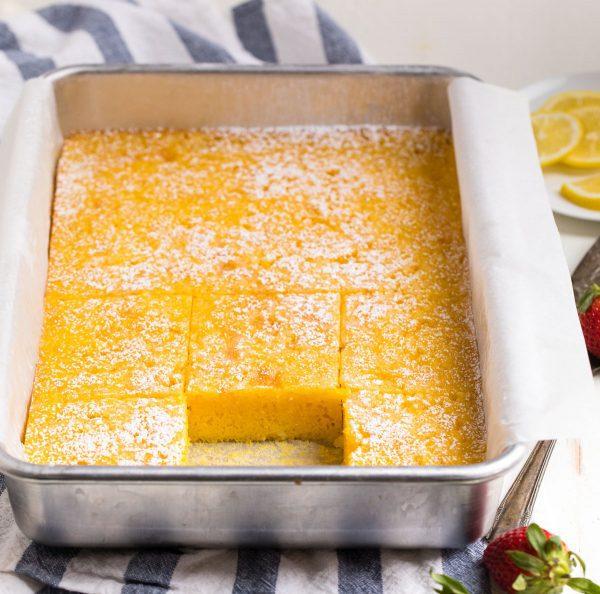 PERFECT Lemon Poke Cake. A super-easy cake using yellow cake mix and lemon jello.