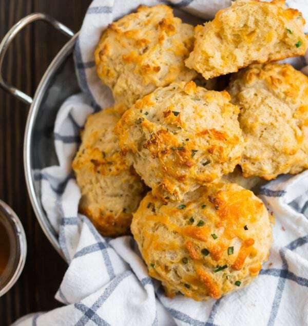 How to make THE BEST Easy Drop Biscuits! No self rising flour or buttermilk required. Light, fluffy, and moist! This healthy drop biscuit recipe tastes like the Pioneer Woman but is made with whole wheat flour and Greek yogurt. Add cheddar, herbs, or any ingredient you love.